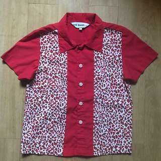 Red animal print polo
