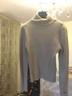 Beige lambs wool title neck