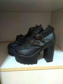 Black buckled heels