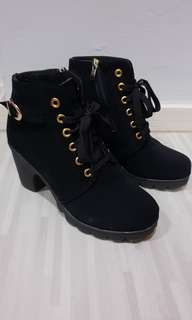 Black one inch heeled boots