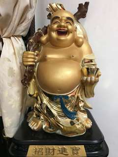 Laughing Buddha statue for adoption