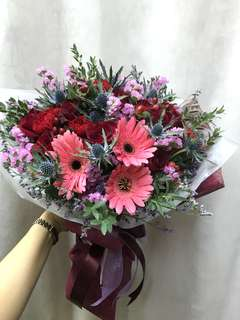 Red roses, red carnations, eryngium, berries etc bouquet