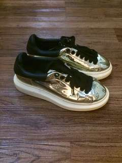 Alexander McQueen gold/black low-top sneakers