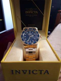 Gold Brand New Invicta Watch (negotiable)