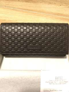 Brand new Gucci Embossed leather brown long wallet
