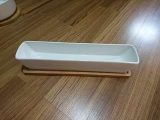White creamic rectangle pot with drainage and wood base