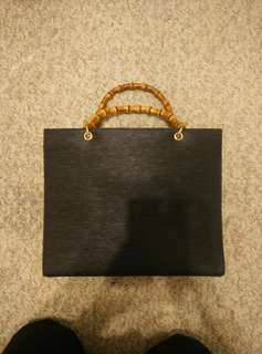 Black purse with bamboo handles