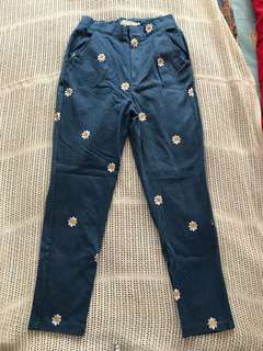 High waisted jeans with daisy prints