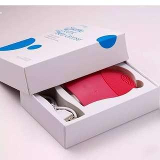 Facial brush electric pink
