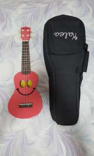 Pink smiley ukulele