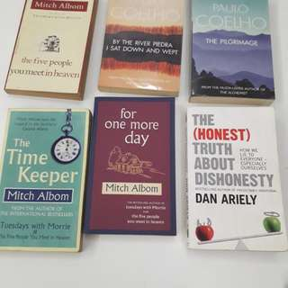 Books by Mitch Albom, Paulo Coelho, Dan Ariely