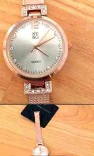 NY&C gold watch