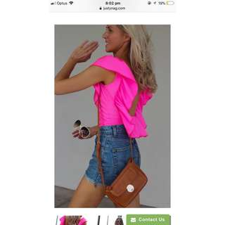 Pink ruffled backless top. Brand new with tags. Size 6-8