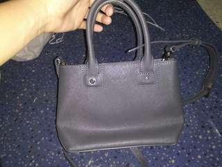Agnes B. handbag and sling bag