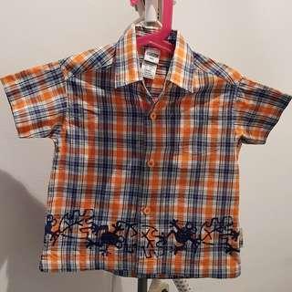Osh Kosh checkered shirt.