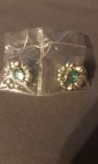 new in package. Antiqued floral birthstone colored earrings