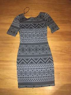 Tight, low back dress