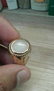 Gold plated white exotic ring.