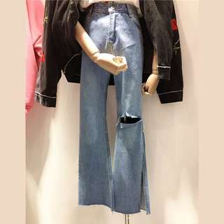 Bell Bottom Ripped Knee Jeans
