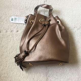 NEW MUMUSO Bucket Mini Backpack Drawstring Bag with Tassel (Bronze)