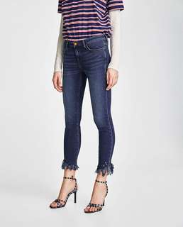 European and American women's clothing shuffles decorated with low-rise jeans