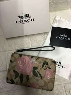Authentic quality Coach wristlet with box