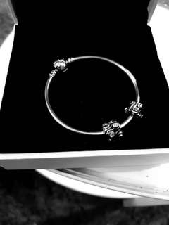 Authentic Pandora Bracelet with 2 Charms