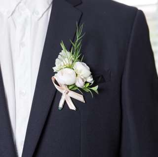Matching bridesmaid and groomsmen corsages and boutonnière
