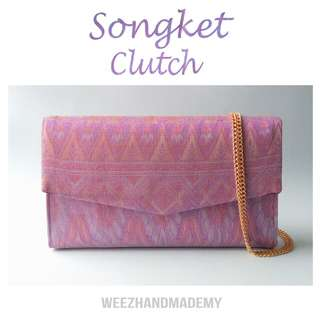 Purple songket clutch