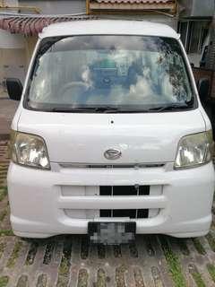 Pearl White Daihatsu Hijet for rent