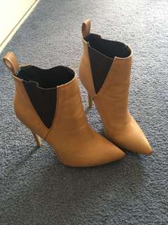Tan leather boots worn few times. Size 7
