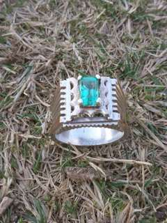 real emralled ring with 925 silver few line gold