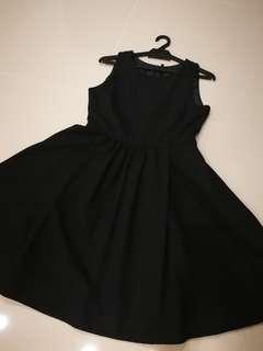Simple black dress with hidden pockets