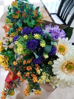 Box of artificial flowers