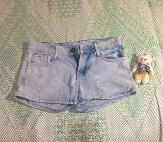 Washed-out ripped denim shorts