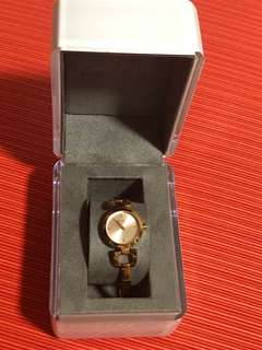 DNKY watch rose gold metal strap