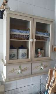 A wooden wall-mounted display cabinet.