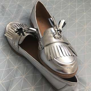 RUBI metallic tasseled flats