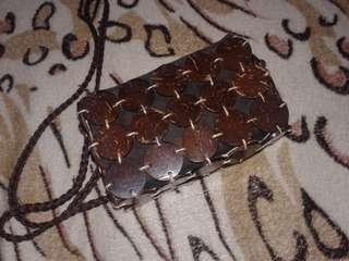 Rattan sling bag.
