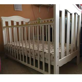 Baby cot (solid wood) in good condition
