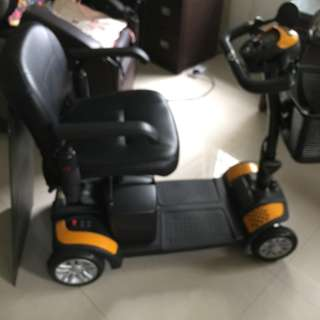 MOTORIZED WHEEL CHAIR WITH RAMP