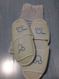 Two Disney bathroom slipper