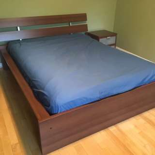 IKEA queen size bed frame and rolling night table