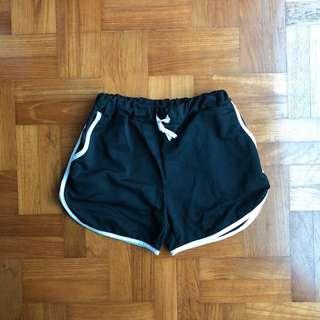 black drawstring runner shorts