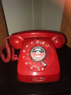 Beautiful red telecom rotary telephone