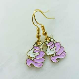 Dangling purple unicorn earrings