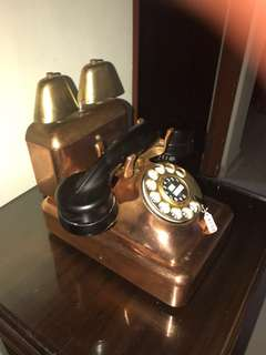 Vintage Cowbell rotary telephone