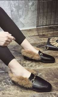 Black loafers with fur