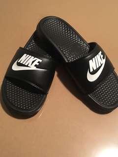 Nike slip ons.