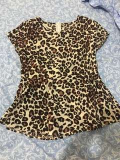 Peplum leopard top